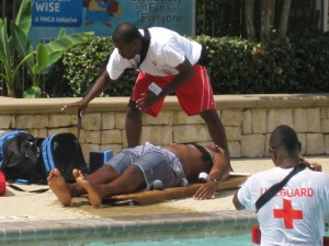 YMCA lifeguards perform a mock rescue of a drowning victim
