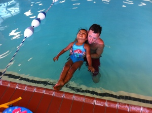 Mr. Manny gives my daughter a swim lesson