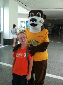 Colin poses with Ollie the Otter, Moody Gardens' mascot