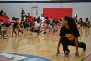 MD Anderson YMCA day campers dance with THE LION KING cast