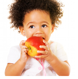 Picture of a little girl eating an apple