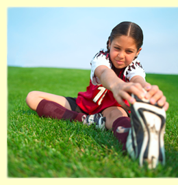 Young girl stretching for soccer practice