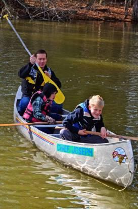 Boys canoe on Lake Livingston at YMCA Camp Cullen.